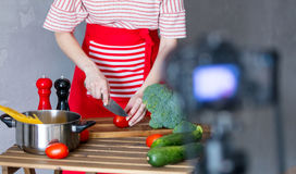 Woman cooking for Video-sharing website Royalty Free Stock Images