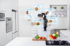 Woman cooking with virtual reality glasses Royalty Free Stock Images