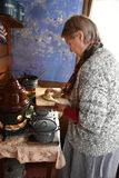 Woman cooking Zuiderzee Museum Stock Images