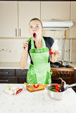 Woman cooks dinner in the kitchen Stock Images