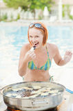 Woman cooks food Stock Photography