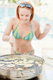 Woman cooks food Stock Photos