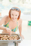 Woman cooks food Stock Images