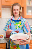 The woman cooks jam Royalty Free Stock Image