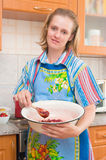 The woman cooks jam Stock Photography