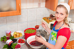The woman cooks jam Stock Photos