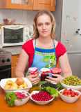 The woman cooks jam Stock Photo