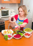 The woman cooks jam Royalty Free Stock Photos