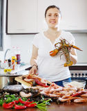 Woman cooks seafood Royalty Free Stock Photography