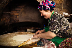 Woman cooks a traditional Turkish pancake Royalty Free Stock Photo