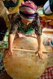 Woman cooks a traditional Turkish pancake Stock Photos