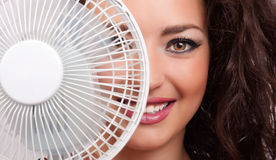 Woman with cooler fan Stock Images