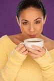 Woman cooling down her coffee Royalty Free Stock Photos