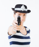 Woman cop aiming gun Stock Images