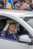 Woman cop give one official salute Stock Image