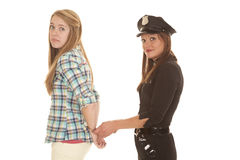 Woman cop handcuff woman behind back Stock Photos