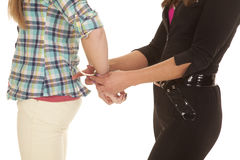 Woman cop handcuff woman close hands Stock Images