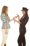 Woman cop handcuff woman pointing Stock Image