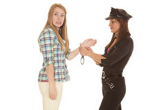 Woman cop handcuff woman upset Royalty Free Stock Photos