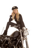 Woman cop motorcycle stand foot on Stock Images