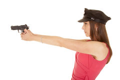 Woman cop pink dress gun face side point Stock Images