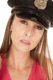 Woman cop pink top hat serious close Royalty Free Stock Photography