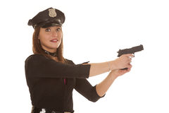 Woman cop point pistol to side Stock Photo