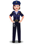 Woman Cop. A cop woman in uniform standing with hands on hips Stock Photo