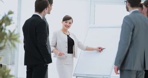 Beautiful woman copywriter and designers stand next to a blank p Stock Images