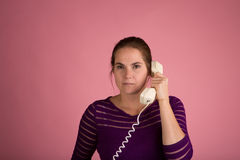 Woman on Corded Phone Stock Photo