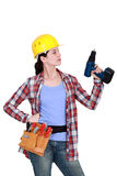 Woman with a cordless drill Royalty Free Stock Photos