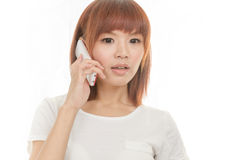 Woman with cordless phone Royalty Free Stock Image