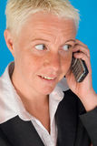 Woman with cordless telephone Royalty Free Stock Image
