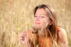Woman in corn Stock Images