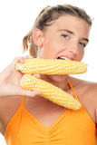 Woman with corn cobs Stock Images