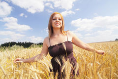 Woman in corn field Royalty Free Stock Photo