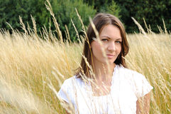 Woman in corn field Stock Image