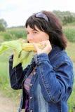 Woman in corn. Field in aun stock photography