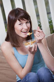 Woman with corn flakes Royalty Free Stock Photos