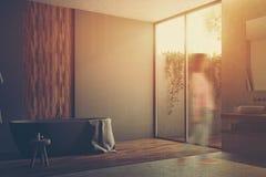 Gray and wooden bathroom corner toned Stock Photo