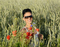 Woman in cornfield. Lauging young  woman with bouquet in cornfield Stock Photography