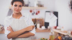 Woman with corolla standing in the kitchen. Isolated Stock Images