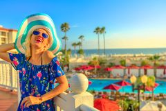 Woman in Coronado Island. Summer holidays in California. Happy lifestyle tourist woman in hat enjoying in Coronado Island, San Diego. Aerial view of swimming stock photo