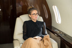 Woman in corporate jet relaxing. Corporate travel and business shooting Royalty Free Stock Images