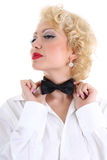 Woman correcting a bow-tie. Young blondie woman in white shirt correcting a bow-tie Stock Image