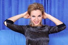 Woman correcting hairs Royalty Free Stock Images