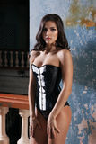 Woman in corset. Beautiful sexy woman in corset in an abandoned house Stock Photo