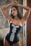 Woman in corset. Beautiful sexy woman in corset in an abandoned house Royalty Free Stock Image
