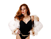 Woman in corset and fur jacked. Royalty Free Stock Photos