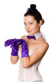 Woman in corset, gloves and little hat Stock Photography